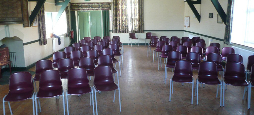 Itton Village Hall chairs laid out for a performance